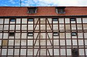 Facade of old half-timbered house in Klaipeda, Lithuania.                            poster