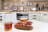 White Toaster, Cup Of Black Tea, Stack Of Toasted Bread, Crispy Toast With Raspberry Jam, Spoon And  poster