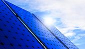 Solar Panels On Blue Sky Background. Photovoltaic Cells Of Solar Panel Generating Clean Energy From  poster