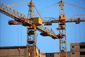 Old Construction Cranes At The Construction Of Panel Apartment Buildings. Construction Site With Cra poster