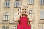 Devoted To Beautiful Music. Happy Kid Listen To Music Outdoor. Adorable Small Child Enjoy Music Play poster