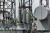 Three Phase Distribution Transformer In An Electrical Substation, Current Transformer, Close Up On T poster