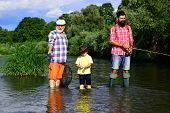 Grandfather, Father And Grandson Fishing Together. Grandson With Father And Grandfather Fishing By L poster