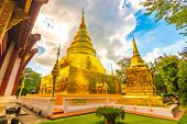 Beautiful View Of Wat Phra Singh Temple With Golden Chedi Stupa And Pagoda In Chiang Mai City, Thail poster