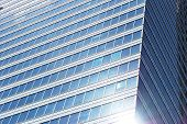 Geometric Reflection: Partly Cloudy Sky Reflected By Window Panes Of Office Building. Surface Of Gla poster