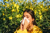 Woman With Napkin Fighting Blossom Allergie Outdoor. Allergy To Flowering. Young Woman Is Going To S poster