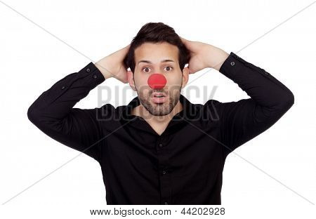Astonished businessman with clown nose isolated on white background