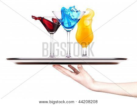 Alcoholic Cocktail  With Splash On A Tray With Hand