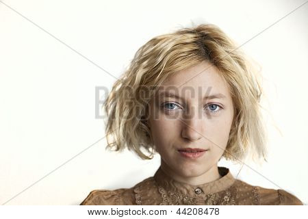Blonde Young Woman With Beautiful Blue Eyes
