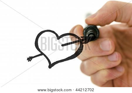 Male Hand Drawing Heart Shape Pierced With Arrow