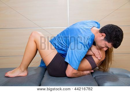 Osteopathy dorsal spine manipulation doctor to woman patient