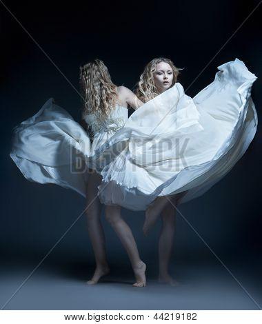 Dancing girl in wedding dress with multiexposition