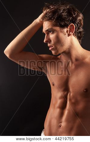 Young sexy male adult looking to the side