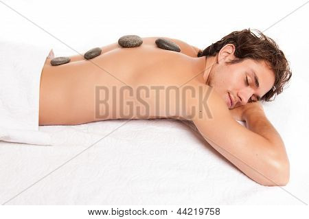 Man receiving a hot stone massage.