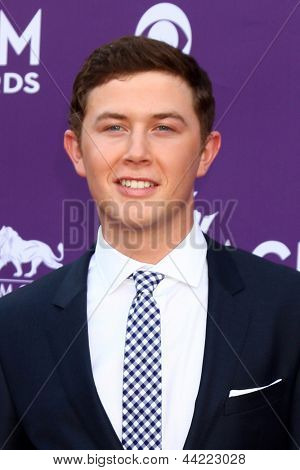 LAS VEGAS - MAR 7:  Scotty McCreery arrives at the 2013 Academy of Country Music Awards at the MGM Grand Garden Arena on March 7, 2013 in Las Vegas, NV