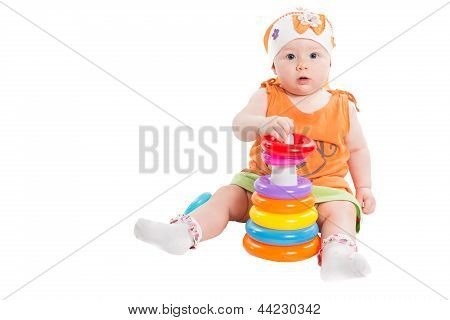 Baby Girl Playing With Colored Pyramid Build From Rings Isolated On White Background. Toy For Childr