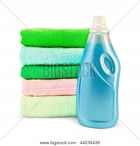 Fabric Softener The Bottle And A Stack Of Towels