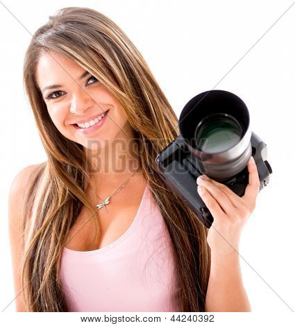 Female photographer holding a professional camera - isolated over white
