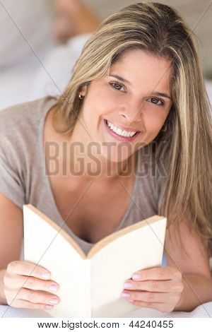 Beautiful woman ralaxing with a book at home