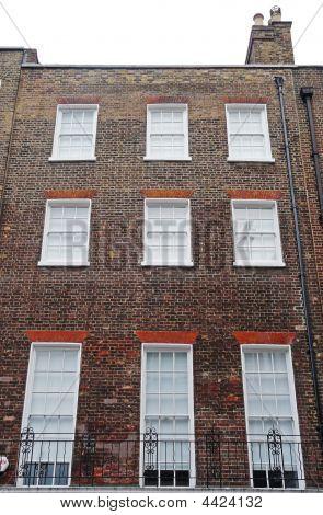 Georgian Windows On A Building Exterior