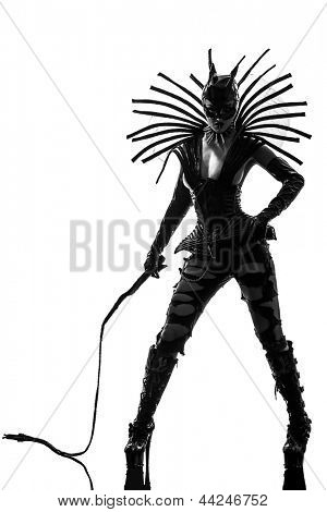 one caucasian woman in catwoman leather latex with whip  in silhouette studio isolated on white background