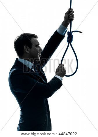 one caucasian man  holding adjusting  hangman's noose in silhouette studio isolated on white background