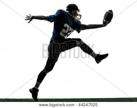 un hombre de jugador de fútbol americano caucásico anotar touchdown en estudio de silueta aislado en Pentecostés