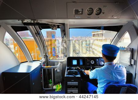 NAHA, JAPAN - NOVEMBER 12: A conductor drives the Okinawa Monorail November 12, 2012 in Naha, JP. Opened in 2003, it's currently the only public railway in Okinawa and the first since World War II.