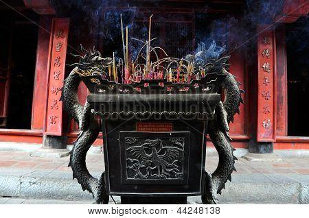 Urn with incense sticks, Vietnam