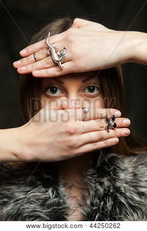 Girl Covering Her Face With Her Hands