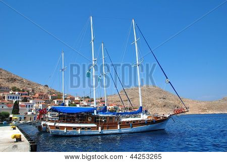 HALKI, GREECE - JUNE 14: Turkish registered tourist boats moored in Emborio harbour on June 14, 2010 on Halki island, Greece. With a population of less than 300 people, Halki is dependent on tourism.