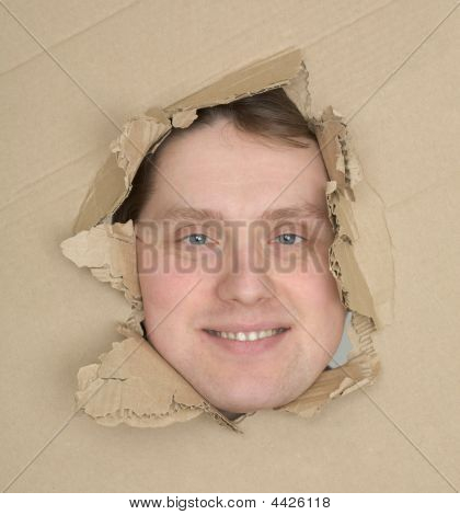 Male Face Look Up Through Hole Carton