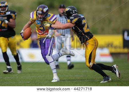 VIENNA, AUSTRIA - JUNE 17 WR Kyle Kaiser (#3 Vikings) is tackled by DB Mario Schmitt (#27 Adler) on June 17, 2012 in Vienna, Austria.