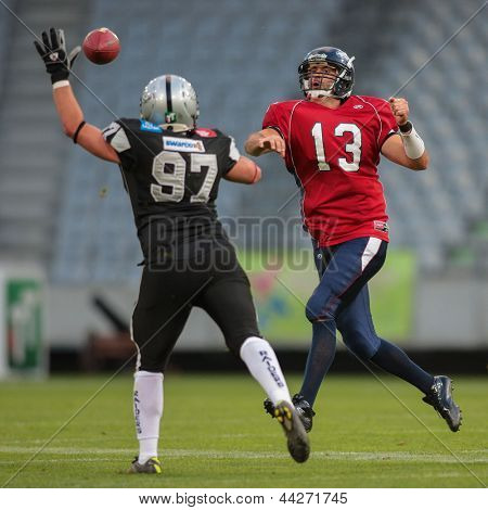 INNSBRUCK, AUSTRIA - JUNE 16 QB Marko Glavic (#13 Broncos) passes the ball on June 16, 2012 in Innsbruck, Austria.