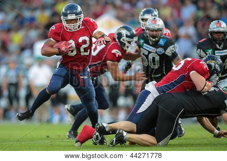 INNSBRUCK, AUSTRIA - JUNE 16 RB DJ Wolfe (#32 Broncos) runs with the ball on June 16, 2012 in Innsbruck, Austria.