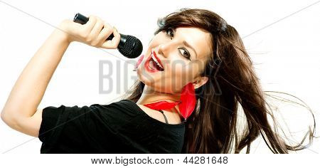 Beautiful Singing Girl. Beauty Woman with Microphone over White Background. Singer. Karaoke
