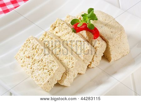 portioned block of tofu with the chili pepper
