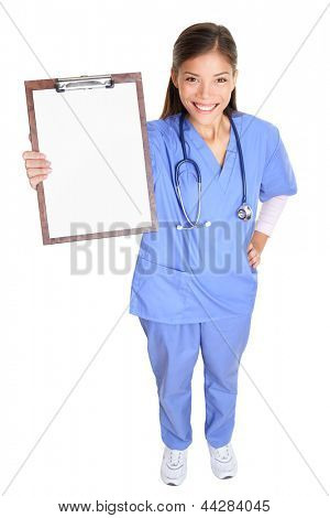 Medical nurse woman or doctor showing clipboard sign standing in full body length smiling happy in blue scrubs isolated on white background in studio. Multicultural female Asian medical professional.