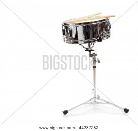 A snare drum with drumsticks on a white background