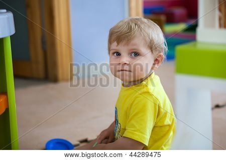 Little Toddler Boy Playing Indoor