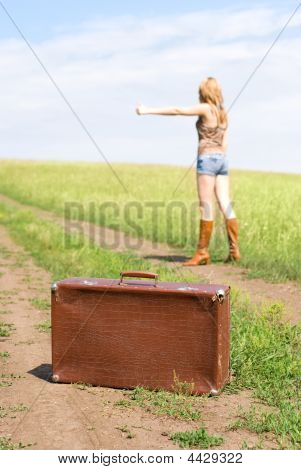 Hitchhiker With A Suitcase