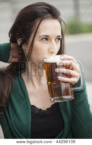 Beautiful Young Woman Holding Mug Of Beer