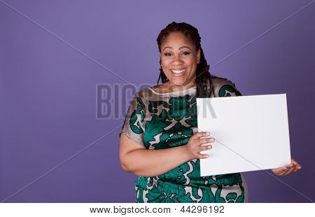 Studio shot of a woman holding a sign