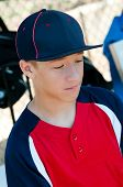 Teen Baseball Boy In Dugout