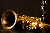 stock photo of sax  - Classic music Sax tenor saxophone and clarinet in black background - JPG