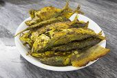 Deep Fried Whole Selar Kuning Fish with Curry Powder Closeup