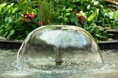 stock photo of fountain grass  - Small Fountain in the city park - JPG