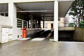 pic of parking lot  - Entrance to parking lot with entry machine - JPG