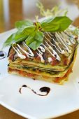 Vegetarian lasagna with vegetables, tomato and pesto sauces