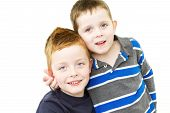 foto of cheeky  - cheeky brothers standing together on white background - JPG